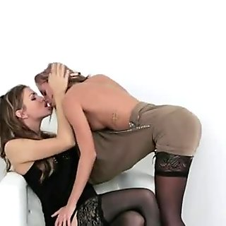 Hot lesbians in lingerie fuck strap on in bed