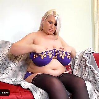 EuropeMature elder round Sami plays with meaty tits