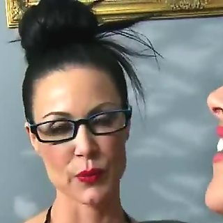 02-Sexy busty lesbians share toys and strapon