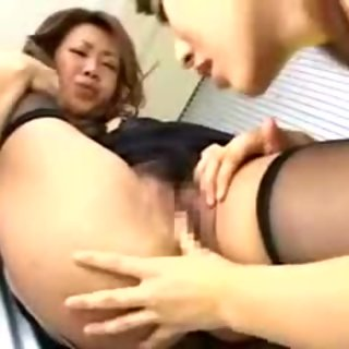 Two hot Asian lesbians munch on pussy before they strapon f