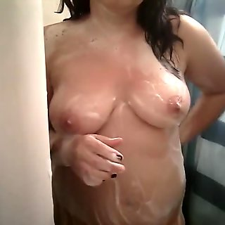 Watch me play with my tits in the shower