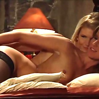 Busty horny naked mistress spoons and cuddles with her slaves