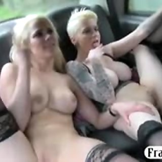 Two busty bitches lesbian sex in the cab for a free fare
